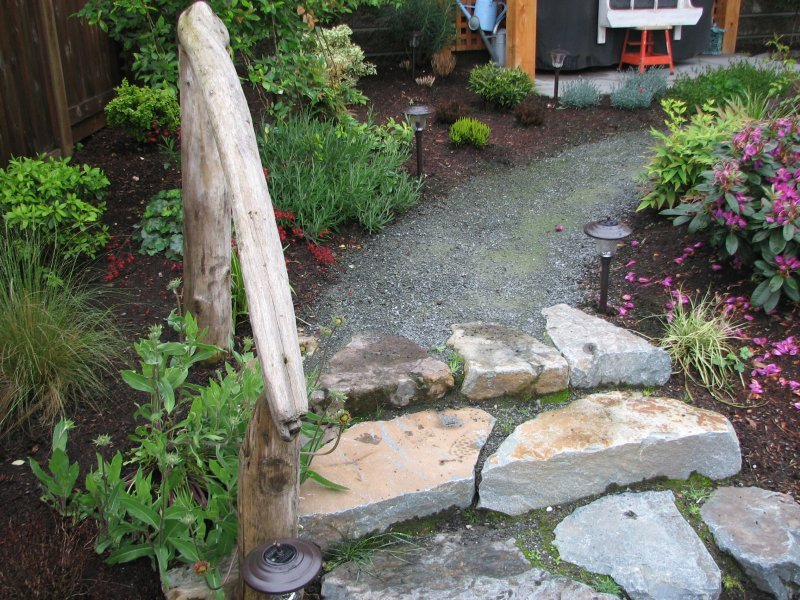 rock staircase with drifwood rail